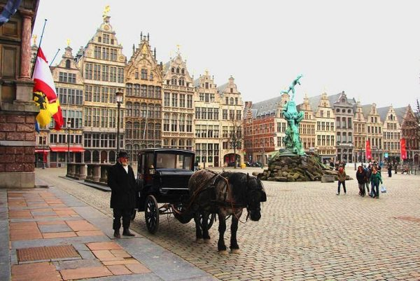 Horse-drawn carriage on Antwerp's Grote Markt.