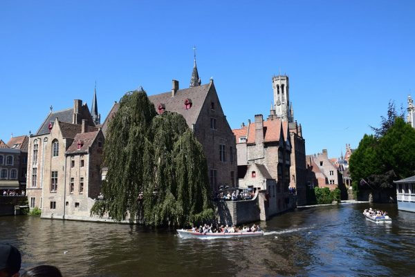 View of the Bruges canals and the Belfry of Bruges.